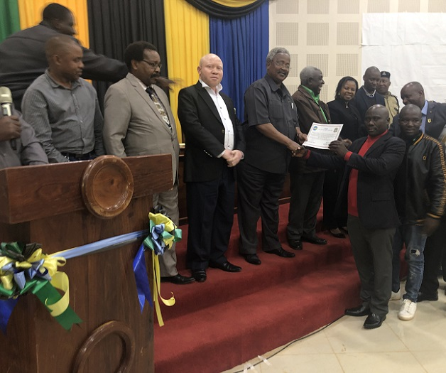 Njombe RC awarding the best performing school in the project area - CERTIFICATE